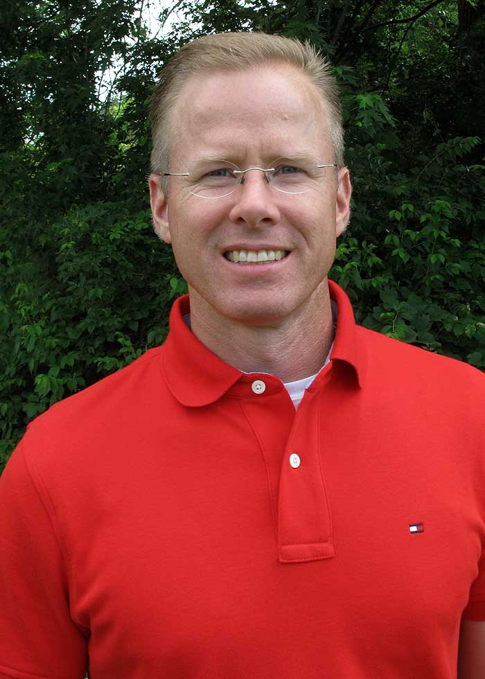 Picture of Dr. James M. Cox II, DC, LAc in a red polo